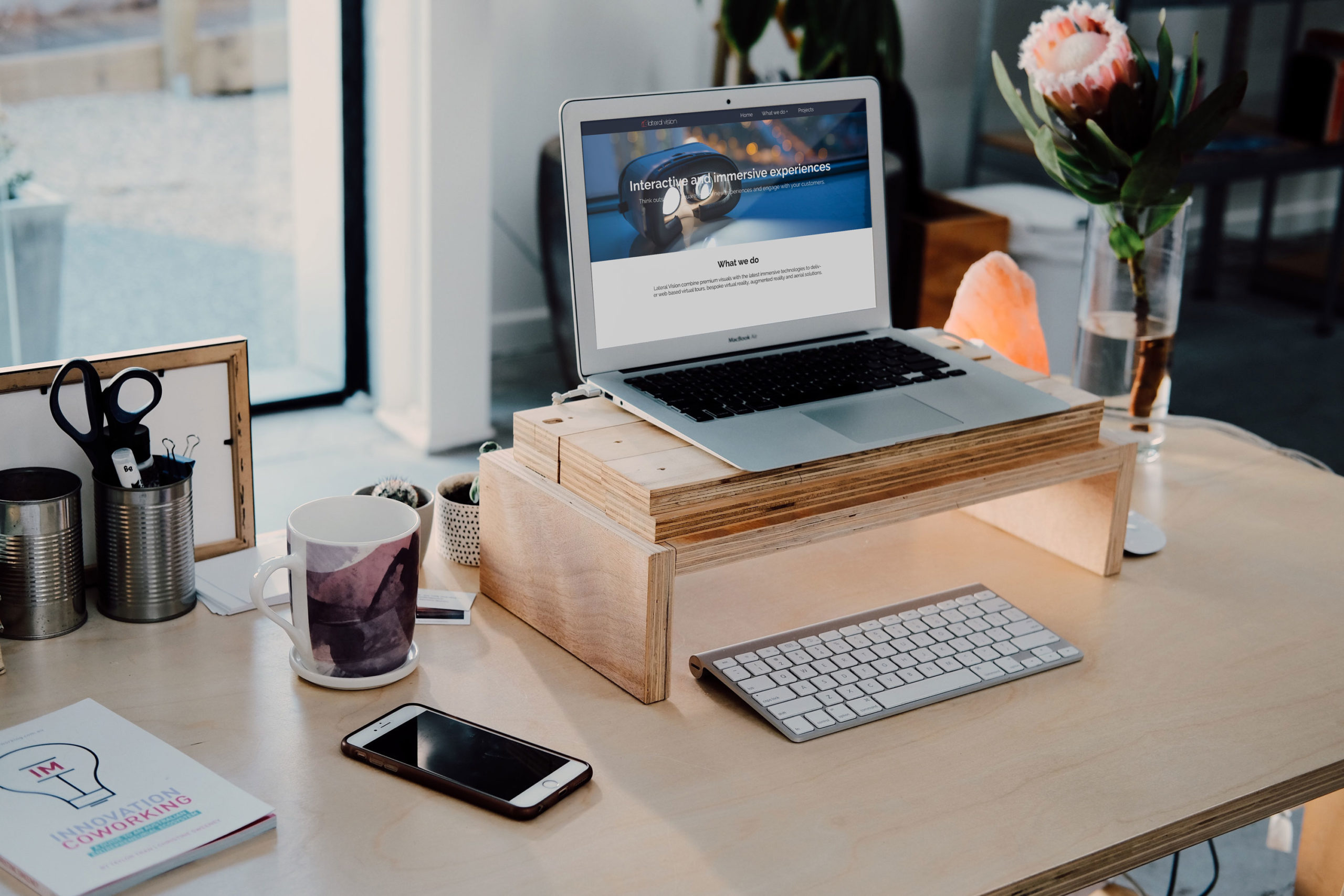 Desktop scene showing Lateral Vision website on a laptop